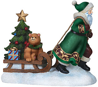 Limited Edition Along for the Ride Santa Figurine by Pipka