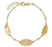 Italian Gold 7 Two-Tone Oval Disk Station Bracelet 14K, 3.0g - J381660