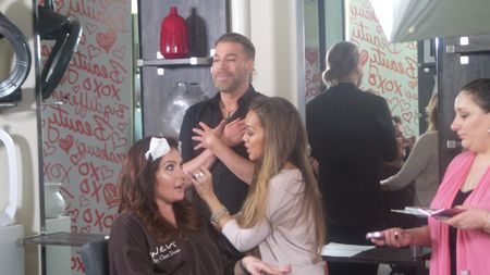 Mally doing makeup