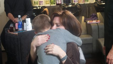Ashley hugging her son after makeover