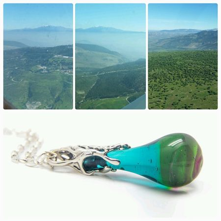 land in Israel and a pendant necklace