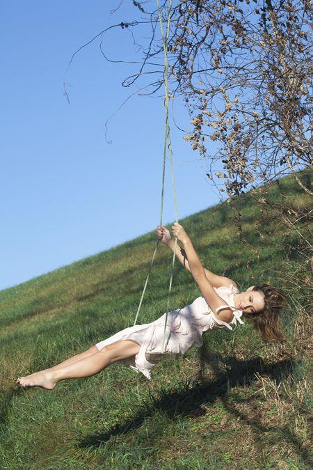 josie swinging on a swing