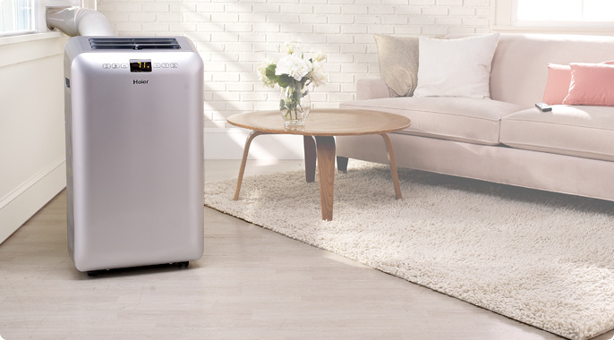 Haier 13000BTU Portable Air Conditioner with timer and remote.