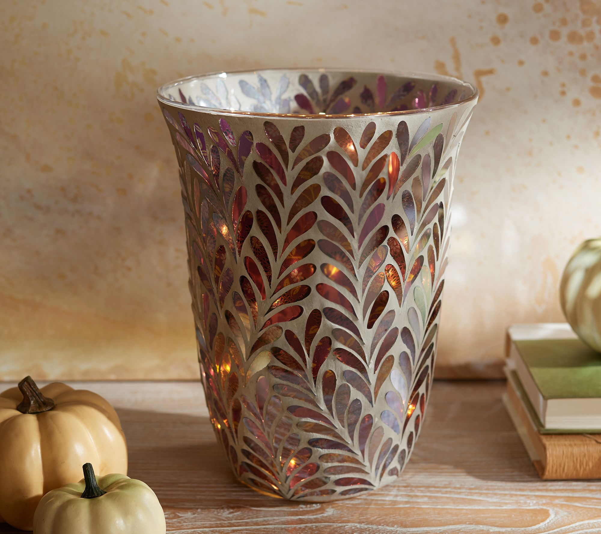 Curved vase with glowing mosaic leaf design
