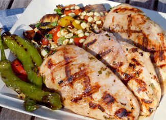 Lemon Rosemary Grilled Chicken Breasts with Zucchini, Corn, and Cherry Tomatoes
